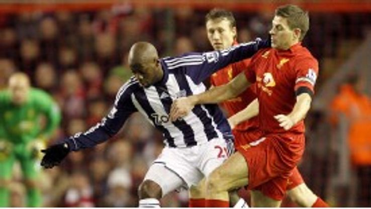 Youssouf Mulumbu holds off and Liverpool's Steven Gerrard
