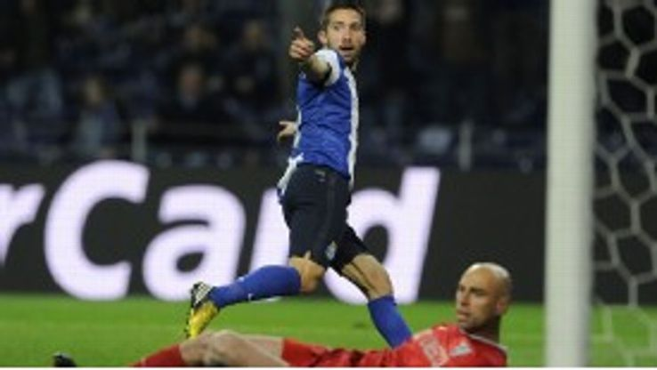 Joao Moutinho wheels away after putting Porto in front against Malaga
