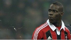 Mario Balotelli appears to spit towards Inter Milan fans during the Milan derby