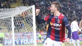 Marco Motta celebrates after neeting an equaliser for Bologna