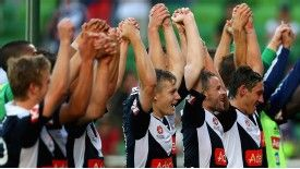 Melbourne Victory players celebrate a 5-0 win over the Newcastle Jets