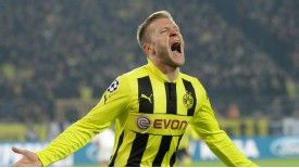 Jakub Blaszczykowski celebrates after scoring against Shakhtar