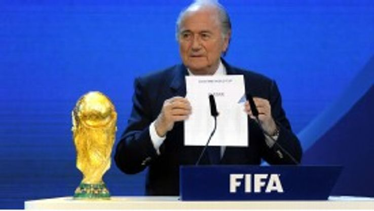 Sepp Blatter reveals Qatar as the 2022 host nation.