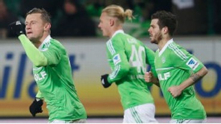 Ivica Olic celebrates after equalising for Wolfsburg
