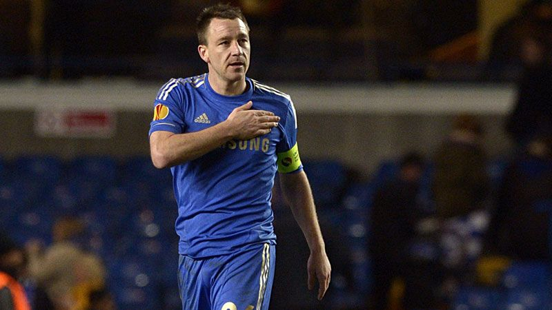 Chelsea captain John Terry salutes the club's fans after winning the last-16 tie against Steaua Bucharest