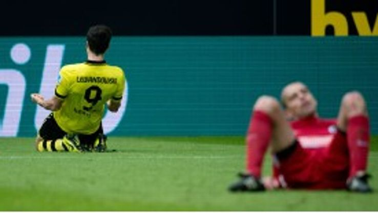 Robert Lewandowski celebrates putting Borussia Dortmund 3-1 up against Freiburg