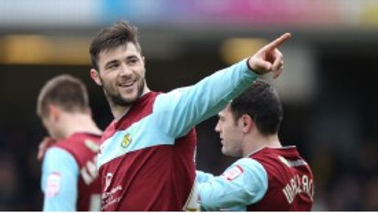 Charlie Austin scored twice for Burnley in their 3-3 draw against promotion-chasing Watford