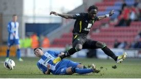 Antolin Alcaraz battles for the ball with Norwich City's Kei Kamara