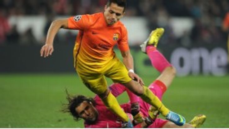 Alexis Sanchez is brought down in the box by PSG goalkeeper Salvatore Sirigu
