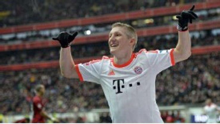 Bastian Schweinsteiger celebrates after breaking the deadlock for Bayern