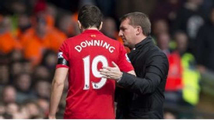 Brendan Rodgers checks on Stewart Downing after the winger is forced off injured against West Ham