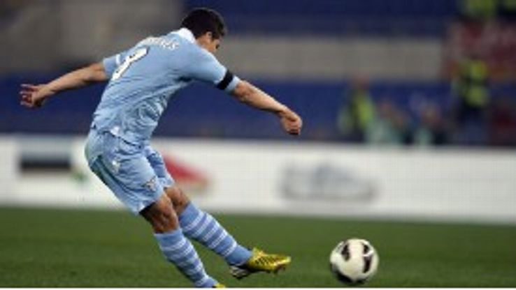 Hernanes fires home the opening goal during Lazio's game against Roma
