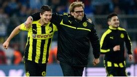 Dortmund coach Jurgen Klopp celebrates his side's dramatic win over Malaga with Robert Lewandowski