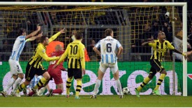 Dortmund's Santana celebrates his winner as Malaga protest