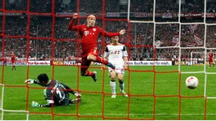 Arjen Robben scores Bayern's second against Wolfsburg