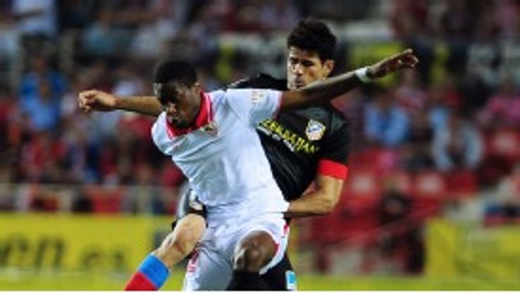 Diego Costa challenges Geoffrey Kondogbia during his side's victory over Sevilla