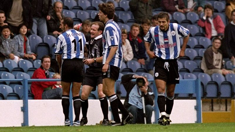 Paolo Di Canio pushes referee Paul Alcock after receiving a red card