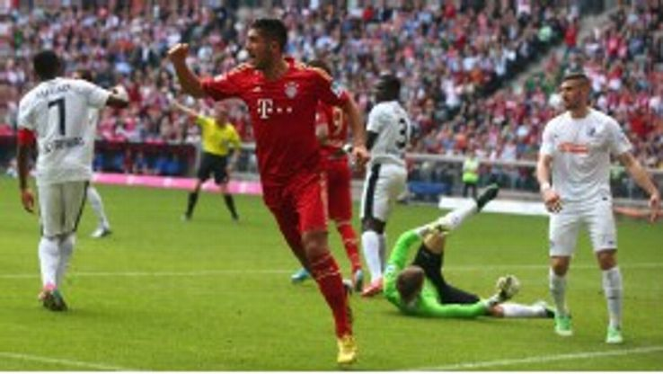 Emre Can celebrates giving Bayern the lead against Freiburg