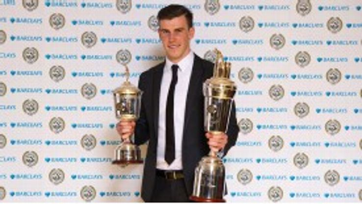 Gareth Bale poses with his PFA Player of the Year and Young Player of the Year awards