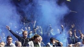 Everton fans light a flare during the Merseyside derby at Anfield