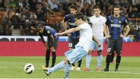 Hernanes scores a penalty for Lazio during their Serie A game against Inter Milan