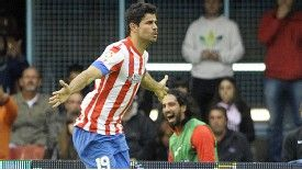 Diego Costa celebrates scoring against Celta Vigo