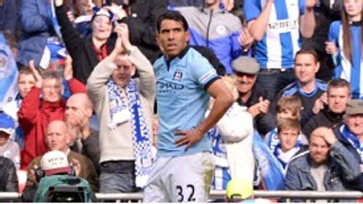Carlos Tevez shows his frustration after missing a golden chance to break the deadlock