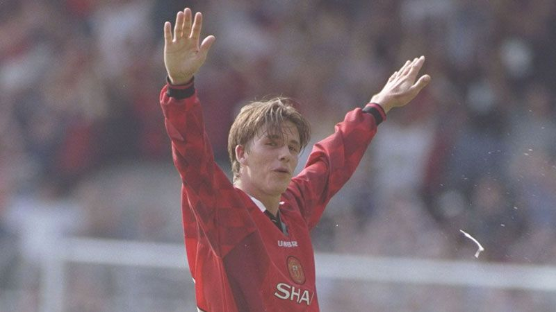 David Beckham celebrates after putting himself in the spotlight by scoring from the halfway line against Wimbledon in 1996