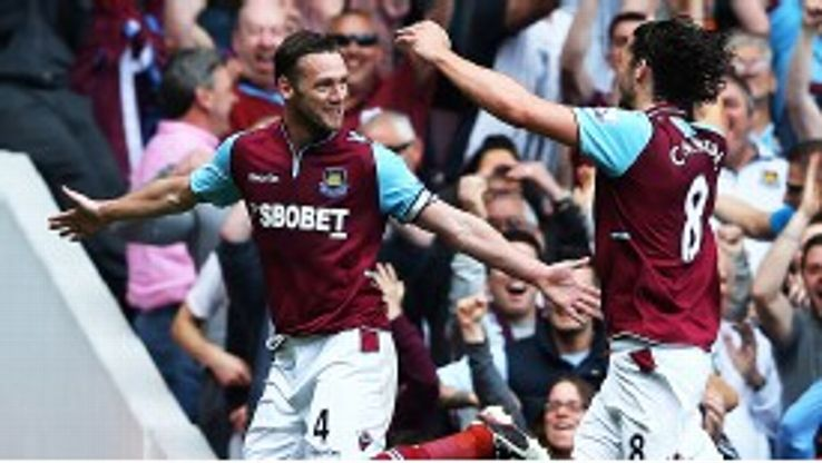 Kevin Nolan celebrates with Andy Carroll after putting West Ham into the lead against Reading