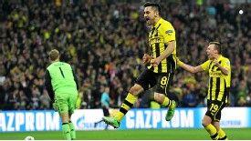 Ilkay Gundogan gave Borussia Dortmund hope by sending Manuel Neuer the wrong way from the penalty spot