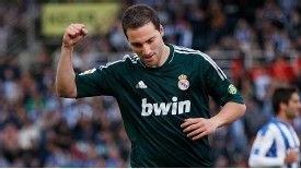 Gonzalo Higuain celebrates after putting Real Madrid in front just six minutes into their game at Real Sociedad