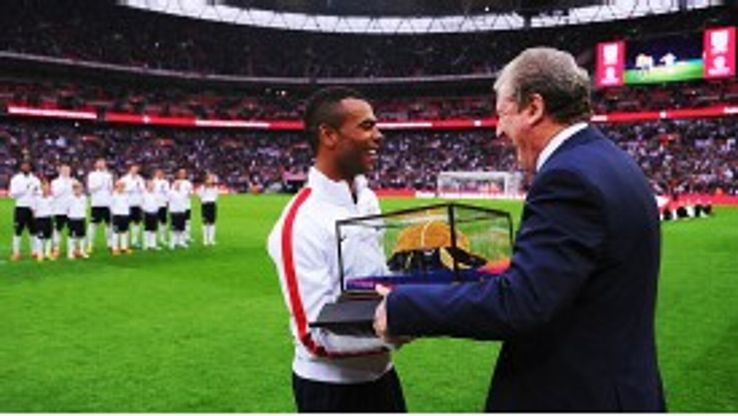 Captain for the day Ashley Cole gets a warm reception when receiving a gold 100th England cap from Roy Hodgson