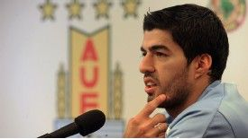 Luis Suarez addresses the media in his native Uruguay