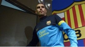 Victor Valdes leaves the press conference at the Camp Nou after explaining his desire to move on
