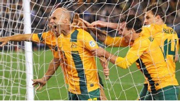 Australia celebrate Mark Bresciano's goal