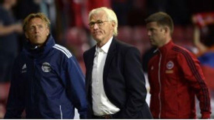 Morten Olsen leaves the field after his side's crushing defeat in Copenhagen