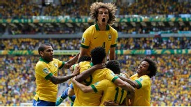David Luiz jumps for joy after Brazil scored against Japan