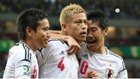 Keisuke Honda celebrates his opening goal against Italy.