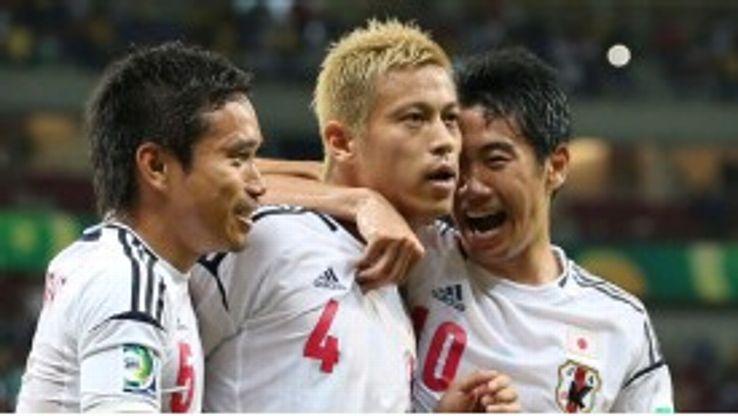 Keisuke Honda celebrates his opening goal against Italy.