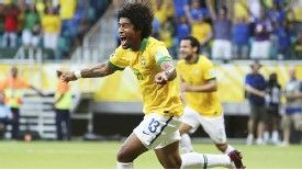 Dante celebrates after giving Brazil the lead against Italy