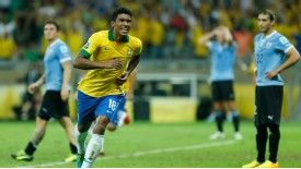 Paulinho celebrates after scoring the winner against Uruguay.