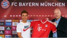 Bayern Munich new boy Mario Gotze alongside sporting director Matthias Sammer