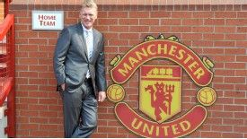 New Manchester United manager David Moyes poses at Old Trafford