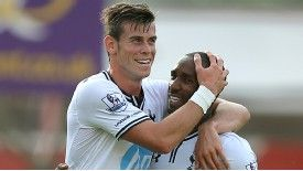 Gareth Bale celebrates with Jermain Defoe