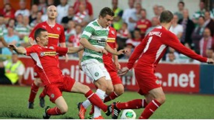 Celtic's James Forrest tries to weave through the Cliftonville defence.
