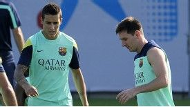 Cristian Tello and Lionel Messi take part in training.