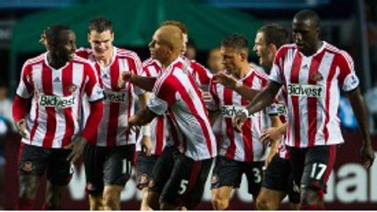Wes Brown celebrates after netting for Sunderland against Tottenham.