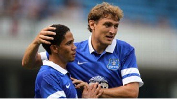 Steven Pienaar and Nikica Jelavic celebrate during Everton's pre-season win over Blackburn.