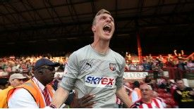 Simon Moore signed for Brentford from Farnborough.