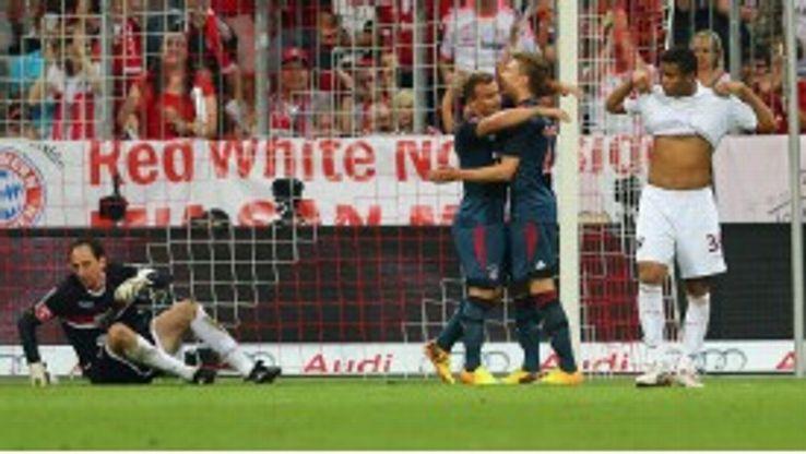 Mitchell Weiser celebrates with Xherdan Shaqiri after doubling Bayern's lead.
